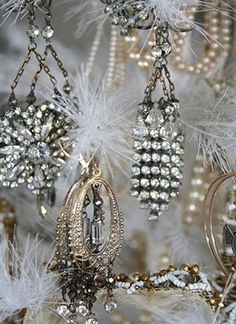 decorating a small tree with old costume jewelry..how glamorous