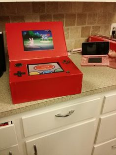 My daughter's Valentine's Box her dad made her! A Nintendo DS playing Pokemon. She loves it!
