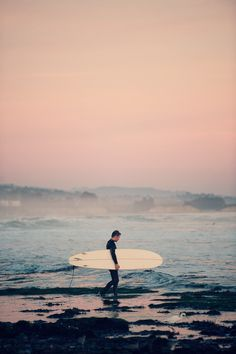 Sunset surf. Lovely pic, terrible idea. Don't you know that's when the sharks are feeding?