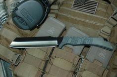 Skallywag Tactical Razor. S35VN steel blade. Looks pretty good and aggressive.