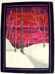 Red Dawn is an original Art Quilt. It is pieced and appliqued with some thread painting. It is just beautiful. Close up details show quilting in different directions to enhance the snow. Love the sky against the snow and the trees.