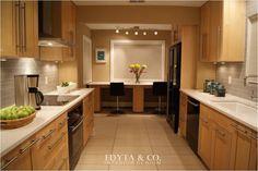 Chicago Modern Kitchen Design. Maple cabinets, White counterops, gray stone backsplash, modern black glass appliances. Eating area. Neutral wall paint. www.edytaandco.com