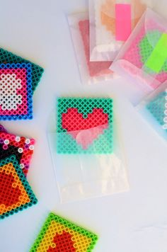 DIY Perler Beads Valentines Tutorial from Camille Styles. Hama Beads Design, Diy Perler Beads, Perler Bead Art, Perler Earrings, Melty Bead Patterns, Hama Beads Patterns, Beading Patterns, Christmas Perler Beads, Peler Beads