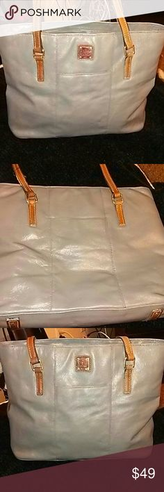 "Dooney & Bourke All Weather Leather Tote Rare and hard to locate Elephant Grey color Leather Handles Large Tote is in Good Used Condition Inside needs cleaning  No rips or tears  This bag has been lovingly used it's not perfect or new but it's in nice used condition. Price reflects that bag is in good used condition. Measures: 14""*14""*12"" Straps: 48"" x 2 Dooney & Bourke Bags Totes"