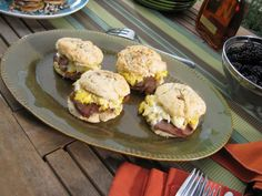 "Bobby Flay layers slices of country ham (he calls it ""American prosciutto"") and scrambled eggs on fluffy homemade biscuits. Serve the extra biscuits with fresh blackberry jam."