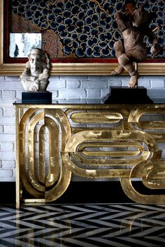 Classy Brass Console. Choose a unique design and that will be all  you need for your hallway
