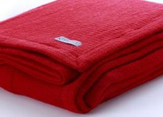 Ruby red NZ Wool blanket. Cosy Toes NZ