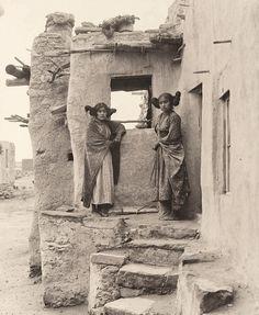 Rare photo of 2 Hopi girls by their pueblo style home. Sichomovi, First Mesa, Arizona. ca. 1900. Photo by Frederick Monsen.