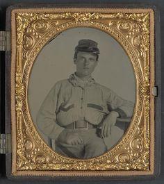 Unidentified soldier in Confederate battleshirt, kepi, and wishbone belt buckle