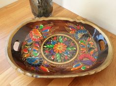 Lovely vintage dark wood tray with carved out grips originating from Russia. From BelieveToBeBeautiful on Etsy.