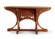 Table Henri Bellery-Desfontaines (1867-1909), decorator House Bellanger, cabinetmaker Paris, 1900 Walnut carved and polished