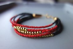 Red and Gold Multi-Strand Statement Bracelet by ana et rana, $18.00 USD