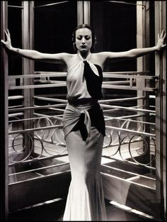 Joan Crawford, 1932 wearing an Adrian gown. http://www.coletterie.com/fashion-history/adrian-image-maker