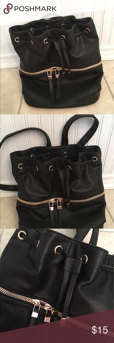F21 Black Faux Leather Bucket Backpack This is so cute and perfect for a chic on the go look. Faux leather, black with gold embellishments and zipper. Make an offer. Everything must go! Forever 21 Bags Backpacks