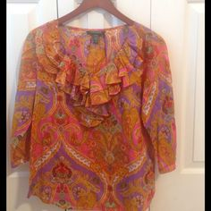 Ralph Lauren peasant blouse This is a beautiful RL top.  It has vibrant colors that are prettier in person. The sheerness of the fabric and 3/4 sleeves are cool and flattering.  The double ruffle tie neckline is perfect for this lightweight cotton fabric. Size is PM Ralph Lauren Tops Blouses