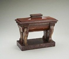 """Rare 19th Century Grand Tour Rosso Antico Marble Sarcophagus Fine rare Rosso Antico marble Grand Tour sarcophagus after the antique on an Egyptian Porphyry base. Italy Circa 1820 restored lid W: 8.5""""-- 21.5cm H: 7""""--18cm D: 4""""--10cm £8000"""