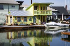 2-story green floating home in Portland, Oregon