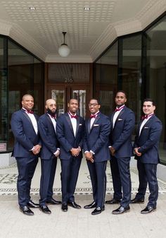 Formal groomsmen outfit idea - blue tuxedos with black oxfords and red bow ties {Story & Rhythm}