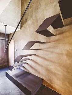 beautiful place, but I would fall both up and down these ridiculous stairs > A Bachelor Pad That Will Sweep You Off Your Feet With Its Stylish Design: The stairs that lead upstairs are very interesting. They're metallic and floating in sets of two, with a minimalist design, simple, straight lines and clean geometric shapes.