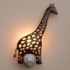 Handcrafted in India with an intricate cutout design, our whimsical giraffe night-light creates ambient illumination for a hallway or bedroom and makes a great gift.