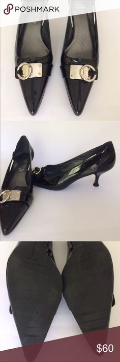 🍂 Stuart Weitzman patent leather pumps🍂 Black SW  patent leather pumps with silver buckle and side cut-outs. Size 8 WIDE. Heel is 2.5 inches. No marks or cuts on heels. Only one small white pencil-thin mark on outside of left foot. Great used condition!! Great for all occasions. Stuart Weitzman Shoes Heels