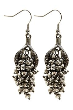 Deliciously opulent with a vintage appeal the Ria Bead Earrings have a subtle chandelier effect that is crafted form dazzling silver glass beads. These earrings have a hook fitting. In the interests of hygiene we do not offer refunds or exchanges on pierced jewellery.