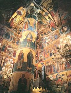 Inside the Cathedral of Assumption, the Kremlin, Moscow. The huge iconostasis dates from 1547, with its two highest tiers are later additions dating 1626, 1653-1654. This cathedral is a Treasury of Orthodox relics such as a Nail from The Savior's Cross, the Stick of St. Peter of Moscow, and The Miraculous Icon painted after the Virgin Mary of Vladimir.