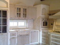 Cucina in muratura con piastrelle in terracotta e top in for Cucina in 3d
