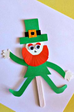 Pin for Later: St. Patrick's Day Crafts For Kids That Are as Good as (a Pot of) Gold Popsicle Stick Leprechaun Puppet Kid will love creating different positions for their tiny Irish friend. Saint Patricks Day Art, St Patricks Day Crafts For Kids, St Patrick's Day Crafts, St. Patricks Day, Holiday Crafts, Fun Crafts, March Crafts, Stick Crafts, Family Crafts