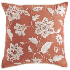 Set on a rusty orange field, our pillow's floral pattern really catches the eye. And with a fringed border and soft, shapely poly insert, it displays both beauty and brains.
