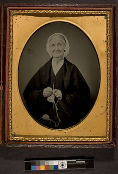 Ambrotype. Elderly woman knitting, looking rather pleased, ca. 1858.