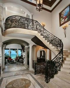 Wrought Iron Stair Railing Staircase Mediterranean with Iron Balcony Iron Railin Stair Railing Ideas Balcony iron Mediterranean railin railing stair Staircase Wrought Luxury Staircase, Interior Staircase, Railing Design, Staircase Design, Foyer Staircase, Railing Ideas, Curved Staircase, Wrought Iron Stair Railing, Iron Railings