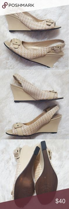 """Stuart Weitzman Peep Toe Wedge Sandal These cream Stuart Weitzman Peep Toe Wedge Sandles are perfect for the summer. They feature a peep toe with faux strap at the toe. Leather sole & fabric flaw at toe flaw left shoe. Small markings on wedges. Heels 3"""" Stuart Weitzman Shoes Wedges"""