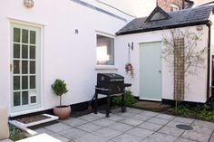 Courtyard garden with pale green and pink accents