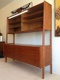 """Hans Wegner for Ry Møbler. Six teak and birch drawers on the bottom half. The top half has two sliding glass doors with 4 adjustable teak shelves. Dimensions: 71"""" wide, 71"""" tall, 19.5"""" deep"""