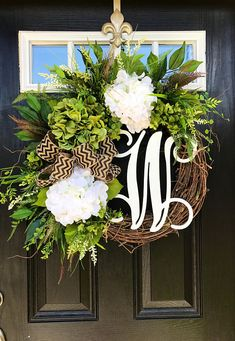 Gorgeous Year Round Door Wreath! Perfect for greeting your guests to your home, with this one of a kind door wreath. Made up on an 18 grapevine wreath with moss, mixed flowing greenery of ferns, ivies, hydrangea leaves and ficus! Beautiful white and lime/mossy green hydrangeas, white