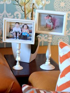 Spray paint frames and candlesticks the same color. Glue the frame to candlestick and let dry overnight. Insert photo and display.   https://www.facebook.com/photo.php?fbid=627346967295395=a.565419626821463.145026.565415993488493=1_count=1
