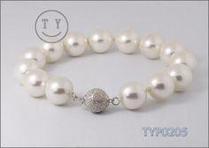 Swarovski Pearl Bracelet 12mm White Shell Pearl Bangle Wedding Jewelry for Bride and Bridesmaids. $6.69, via Etsy.