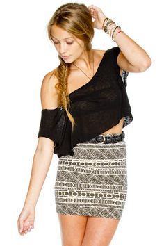 Black lace crop top shoulder showing w/ a tribal print pencil skirt with a black belt accessories: stacked bracelets