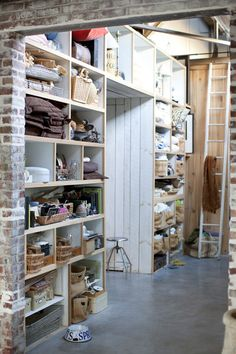 """home of Rob (photographer) and Jill (designer) Brinson. Rob - """"The reason Jill married me: I have 6,500 square feet to store her stuff."""""""