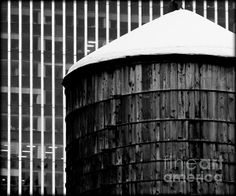 Manhattan Water Tank 3   Artist  James Aiken   Medium  Photograph - Photography   Description  A wooden water storage tank on top of a skyscraper in New York City's borough of Manhattan is framed by an even taller building in the background.