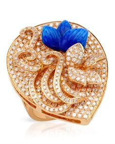 Blossoming rose gold ring with genuine diamonds.