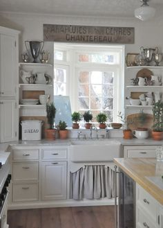 Farm / apron front sink - curtain covering lower cupboard, open shelving - country/cottage kitchen