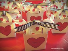 """Valentine favors made from plain, white, fold-it-yourself boxes from the Dollar Tree wedding section:   the ultimate blank canvas """"pour surprises."""""""