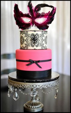 i like this cake minus the mask at the top- You could top it with other things, but this would be a cute bachelorette cake idea...