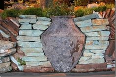 Love the way this vase is incorporated into the stacked stone wall. From Mariposa Gardening and Design at the SF Garden Show. #sfgs