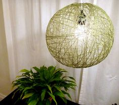 Yarn and light    http://www.instructables.com/id/String-Pendant-Lamp/