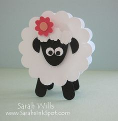 Punchart sheep holds a treat. if you don't have punches, you could also use popsicle sticks for legs and cupcake liners for the body and construction paper plain cardboard for the face  flower.