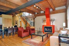 Showed this property to some buyers last year. Duplex-up at 1740 N Marshfield. Loved the ceiling height with wood beams, sky light in stairwell and dramatic staircase. Red fireplace isn't my style (probably mute it to a blueish/grey instead). Still loved this space!