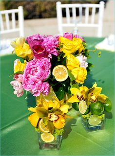 For the couple who wants their wedding flowers to match their personalities. Hot pinks, bright yellows, citrus and fresh grass green. Love this for an outdoor event. I especially love the use of different sized vases to be visually pleasing. They didn't forget those little square vases... Limes and orchids add something extra special to the mix.